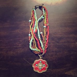 MULTICOLORED BEADED NECKLACE - RED FLOWER PENDANT